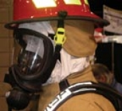 A hood that tucks into the coat collar was added to be CBRN compliant.