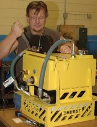 Randy Burleson assembles a reservoir on an Octoflow.