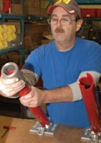 Hurst makes Airshore stabilizing struts. Dan Hicks assembles a strut for an Airshore kit.