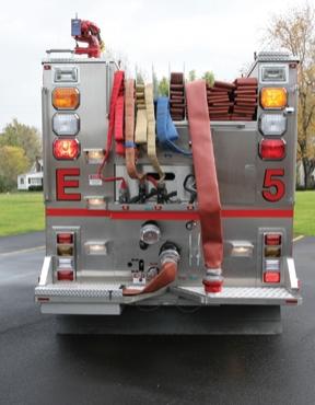 The compartment built into the driver's side rear work platform contains a short five-inch curb jumper for making a big fire hookup.