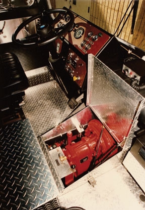 Additional access was via a floor-mounted hinged cover in the cab