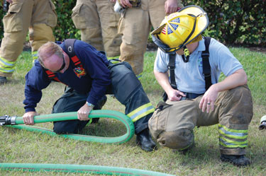 (1) Key Hose's Combat Ready hose is one of the company's more popular attack lines, shown here being doubled over under pressure without kinking.