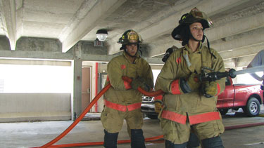 (2) Key Hose's Big 10 1¾-inch attack line with a smooth bore tip is used by two firefighters during a drill.