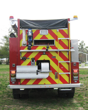 (2) The Waynesville Maverick pumper-tanker has a 10-inch electric dump valve with a Rosenbauer swivel dump at the rear and a 2,100-gallon Portatank on a hinge-down rack on the right side.