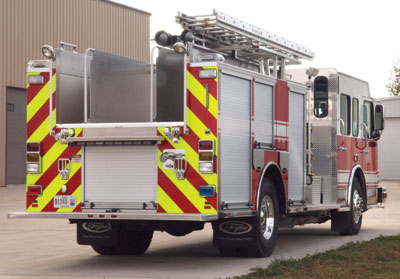 (4) This Toyne pumper has a 1,000-gallon L-shaped tank. Both rear discharges are sleeved through the tank. The 2½-inch connection beneath the right side 2½-inch discharge is a direct tank fill. Use caution when filling.