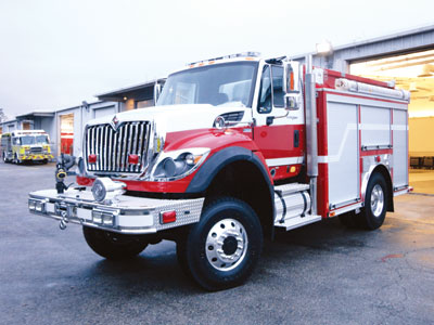 (4) E-ONE built this wildland-urban interface vehicle with a bumper turret, vertical exhaust stack, and rear-mount pump enclosed behind a roll-up door for the Cashiers-Glenville (NC) Volunteer Fire Department.