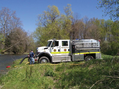 (4) Weltonville Fire Company's coverage area doesn't have many hydrants, so the new Alexis pumper had to be able to access water sources like this waterway.