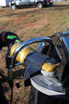 (1) A firefighter uses a Hurst Jaws of Life JL-500 cutter to cut the B-post on a vehicle.