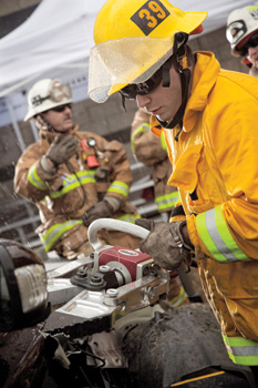 (3) A firefighter uses this Champion Spreading tool on a late-model Volvo.