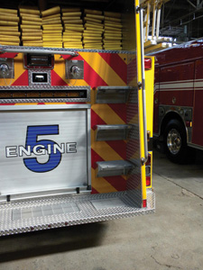 (6) The rear of this apparatus incorporates a rear tailboard, access steps larger than the NFPA's minimum requirement, and handrails that appear to make access and egress user-friendly.