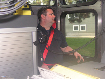 (1) The bright orange seat belt stands out behind dark contrasting backgrounds. This firefighter is seated in position four, directly behind the driver. The officer simply needs to take a quick glance. If the officer can see orange, it's indicative that the firefighter is properly buckled in and nothing needs to be said.