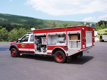 (1) A Hale 4 HPS UHP pump is shown installed on a KME wildland vehicle.