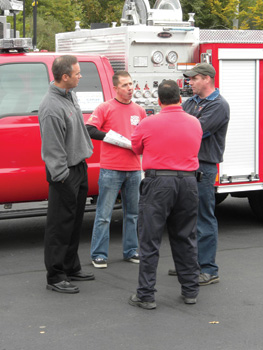 Mark MacDonald, vice president of sales, chats with members of the Canton (MA) Fire Department.