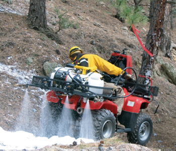 Intelagard makes a SwiftCAF all terrain vehicle for wildland use, shown here laying down a foam blanket.