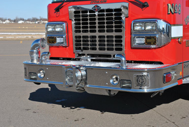 job-specific bumper extension has two center-mounted hose wells with rounded bottoms