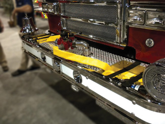 This pumper features hose wells mounted outboard of the frame rails with hose packed on its edge