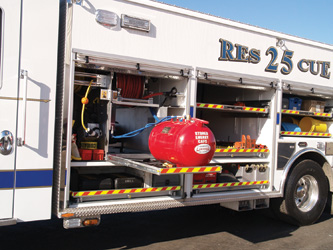 walk-around rescue truck that includes a Burner Fire Control stored energy compressed air foam system