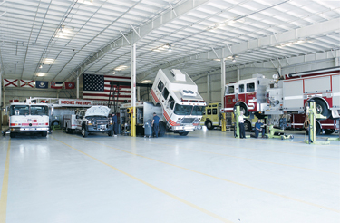 Apparatus inspectors at Sunbelt Fire's Alabama service shop perform inspections on a number of rigs