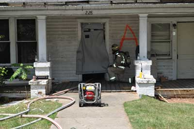 Air curtains are advantageous as exterior doors because they provide fire department personnel with a means of keeping a door opening closed without disrupting hose movement