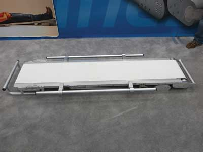 3 With all the hand rails attached, the SpineBoard is leveled out at zero degrees. This model, the EMT Standard, weighs 60.3 pounds. The unit can be carried by two, four, or six EMTs, depending on the patient's weight. It has a rated carrying capacity of 700 pounds