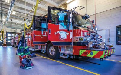 1 Charlottesville (VA) Fire Department (CFD) Engine Company 10 is ready for response in its new home. All utility support comes from overhead for all vehicles.