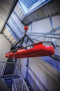 6 Firefighters use the four-story training tower for wet and dry hose exercises, smoke and ventilation scenarios, rappelling inside and outside, and Stokes basket training