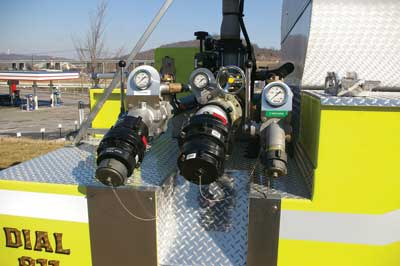 4 The rear of the Bromley foam truck is set up with two discharges: a five- and three-inch. It also has dual intakes-one for static and one for pumped foam.