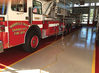 Murrell's Inlet Garden City Fire Department, in Murrell's Inlet, South Carolina, had Rhino Pro Flooring cover its double-deep station floor with a three-color polyaspartic finish design. (Photo courtesy of Rhino Pro Flooring.)