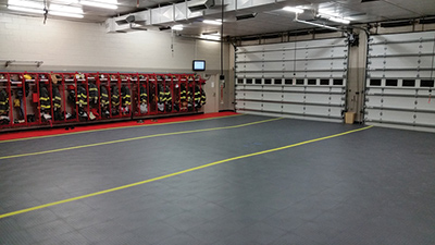 The Watchung (NJ) Fire Department had Armor-Tuff Fire House Flooring cover its four-bay station floor with Supratile and line the bay edges. (Photo courtesy of Armor-Tuff Fire House Flooring.)