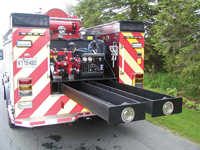 This PFP model pump made by CET Fire Pumps is mounted as a skid unit on the back of a fire vehicle. The pull-out trays are for handlines. (Photo courtesy of CET Fire Pumps.)