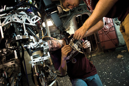 6 Virginia Tech researchers Jack Newton, left, and Mike Rouleau make adjustments to the firefighting robot.