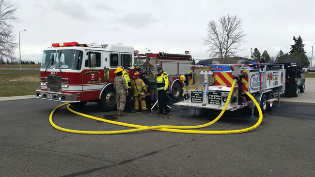 1 Weis Fire & Safety Equipment personnel use a Draft Commander 3000 A/T Mobile Fire Pump Testing and Training Unit to pump test a U.S. Air Force pumper. (Photo courtesy of Weis Fire & Safety Equipment