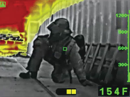 2 A firefighter can use a thermal imaging camera to see the intense heat in this confined space. (Photos courtesy of Bullard