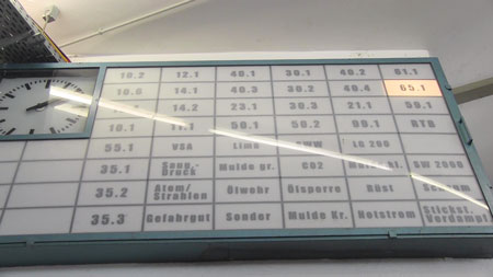 3 The alarm board in the main vehicle hall with all apparatus radio numbers and equipment pods listed