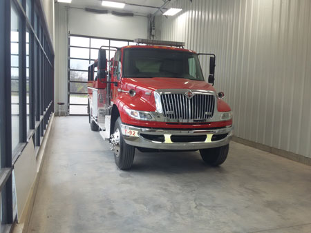 7 A tanker mounted on an International chassis inside Missouri Fire Apparatus's recently completed glass showroom and delivery bay used during the final inspection/purchasing process. (Photos courtesy of Missouri Fire Apparatus