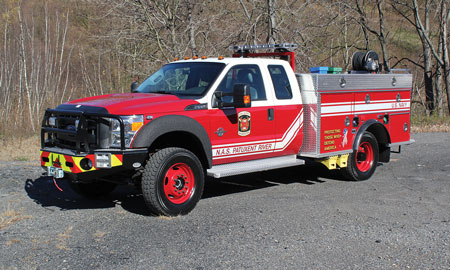 2 The U.S. Navy facility in Patuxent River, Maryland, had KME build this wildland Type 6 patrol unit that includes a dual low-pressure/ultra-high-pressure (LP/UHP) pumping system capable of about 120 gpm at 120 psi and eight gpm at 1,200 psi. (Photo courtesy of KME.)