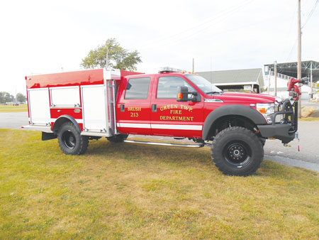 1 The Green Township (OH) Fire Department had KME build this quick-attack brush truck on a Ford F-550 4x4 four-door crew cab chassis powered by a V10 Triton gasoline engine and a Torqshift six-speed automatic transmission. It features a six-inch lift kit and super single rear wheels conversion. (Photos courtesy of Warren Fire Equipment.)