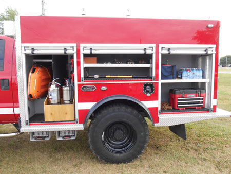 6 KME built a transverse compartment behind the brush truck's extended cab for a Stokes basket and backboards because the Green Township Fire Department uses the vehicle in multiple roles, including responding to vehicle fires and as a backup medical rig