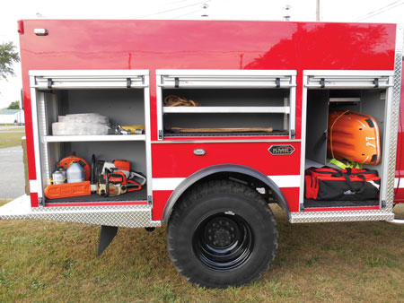 7 KME built a transverse compartment behind the brush truck's extended cab for a Stokes basket and backboards because the Green Township Fire Department uses the vehicle in multiple roles, including responding to vehicle fires and as a backup medical rig