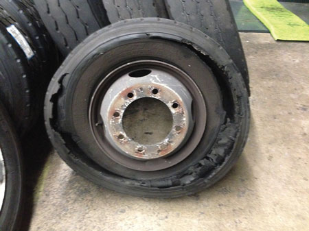 1 An example of a tire that blew because of damage caused while it was run underinflated. It was an inside dual on a rescue truck. <em>(Photo by author.)</em>