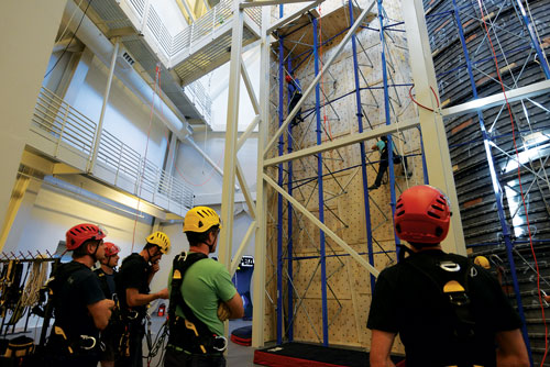 1 The Petzl Technical Institute is a 15,000-square-foot training center that features a 55-foot-tall climbing wall; 5,000 square feet of exposed vertical structure; a 36-foot-tall drop-test tower; and a three-story simulated apartment building for rescue, firefighter evacuation, and confined space training. (Photos courtesy of Petzl America