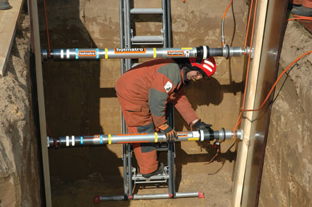 5 Holmatro's PowerShore air-operated strut system is shown being placed in a trench for wall support. (Photo courtesy of Holmatro