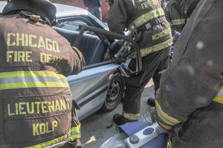 4 A Hurst eDRAULIC S700E2 cutter operated by a Chicago firefighter is used on a vehicle's rear door.