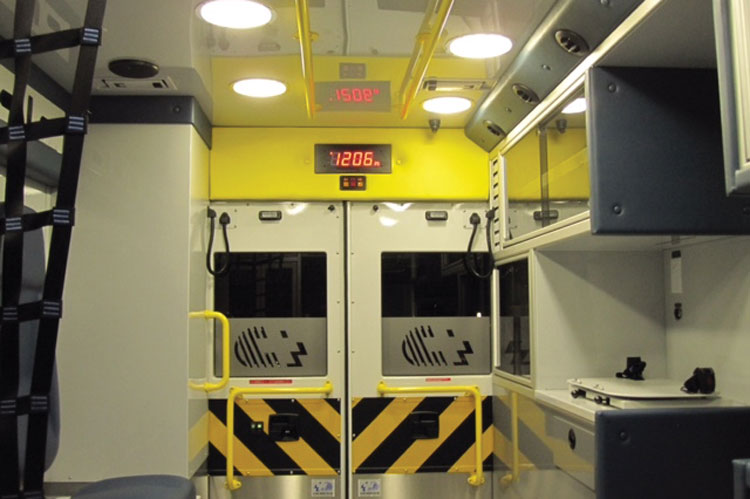 4 Inside the patient module, a digital readout on the back wall displays a digital clock, driver's turn intentions, and rear step lighting. (Photo courtesy of Apgar Ambulance