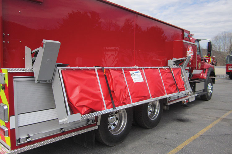 5 This powered portable water tank rack was built and fitted to a 3,000-gallon demo tanker by KME.