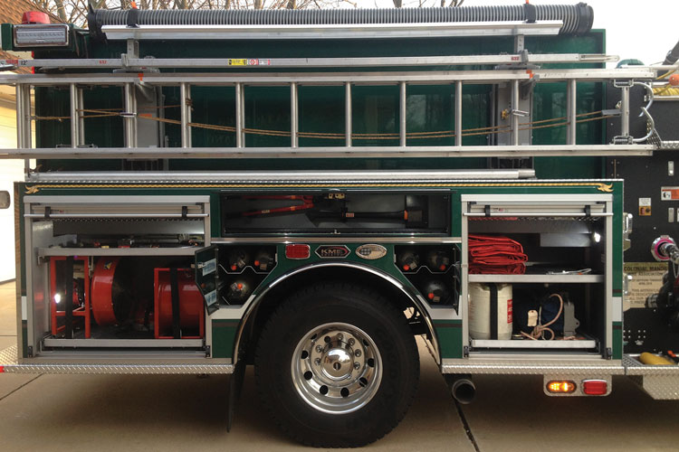 5 The officer's side of Colonial Manor's new pumper is fitted with slide-out trays in all compartments and a Zico electric-over-hydraulic ladder rack.
