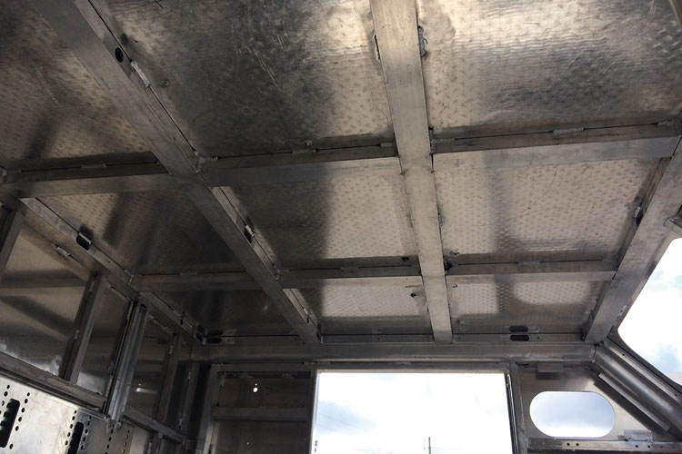4 The 1.5-inch × 3.0-inch rectangular extrusions with a 3⁄16-inch wall thickness are welded into a grid pattern to support the fully welded 3⁄16-inch roof plates.