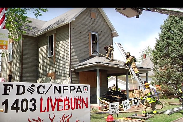 Firefighters conduct a live burn at FDIC International 2017