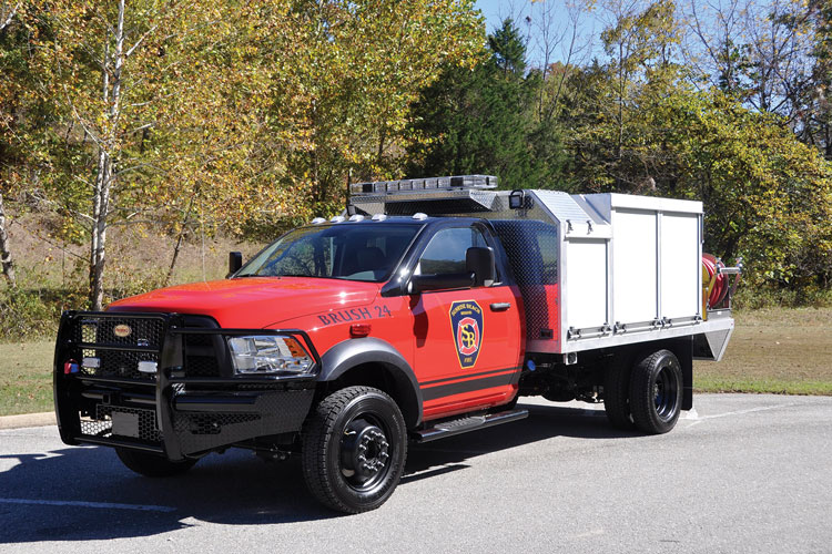 Precision Fire Apparatus built this quick-attack/brush unit for the Sunrise Beach (MO) Fire Department on a Dodge 5500 chassis with a Hale HP200 pump skid unit, 300-gallon water tank, one 1¾-inch hose crosslay, and two one-inch booster reels.