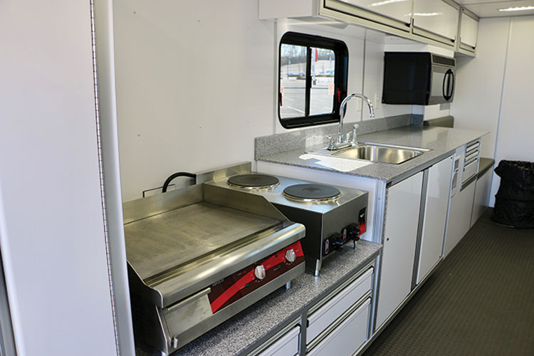 6 The inside of the Rehab Support Unit features a dual-burner short-order stove, a 24-inch commercial griddle, a 1,000-watt microwave, and an 85-gallon onboard water system